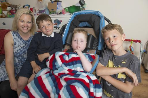 Helena Murray with her family, Jack, Lucas and Jamie, who is cared for at Laura Lynn. Photo: Michael Mac Sweeney