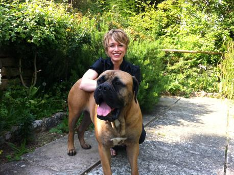 Amanda Revell Walton, pictured with her dog Rosie, hasn't let childlessness stop her fulfilling her 'mothering' dreams