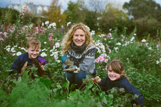 Kitty Scully, head kitchen gardener at Airfield in Dundrum, with Jay Courtney (9) and Jess Courtney (8), both also opposite. Photo: El Keegan.