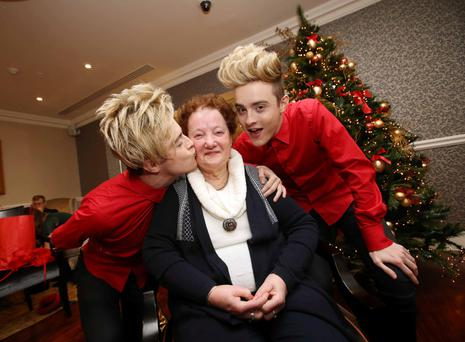 Jedward launch the Alone Christmas campaign with Patricia Stanley from Rathfarnham, Dublin. Alone is highlighting the isolation and loneliness for older people around Christmas, calling on the public to 'Share your Presence' with anoyone who may be isolated or lonely this holiday season. Photo: Sam Boal.