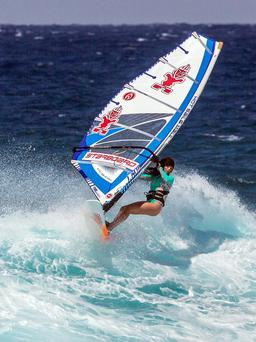 Katie McAnena in action wind-surfing.