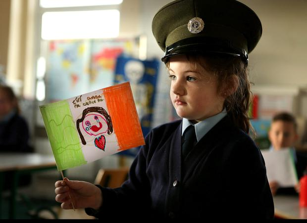 Bright future: Muireann Kavanagh listens as the Proclamation is read to children on Arranmore island off the northwest Donegal coast. Photo: Gerry Mooney.