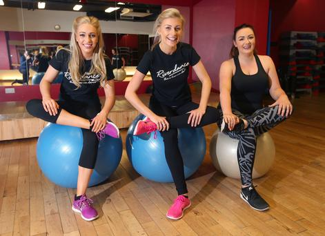 Riverdance dancers Miriam Lee and Orlagh Carthy put Vicki Notaro through her paces. Photo: Damien Eagers.