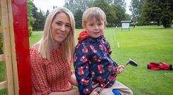 RTÉ presenter Evanne Ní Chuilinn and her son Seimi playing golf at the Spawell Golf course in Dublin. Photo: Arthur Carron.