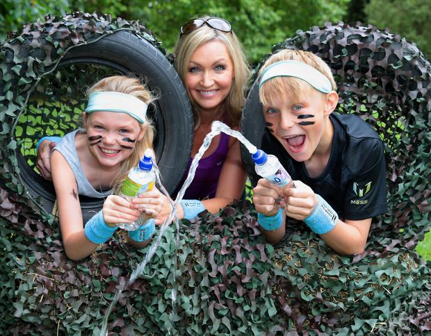 Vivienne Connolly keeps fit with her daughter Katie Dunne (7) and son Ben Dunne (12) at the launch of Fruit Shoot Mini Mudder obstacle course. Photo: Brian McEvoy.
