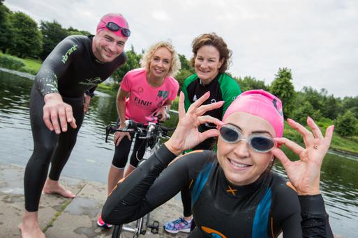 Sonia O'Sullivan, Vodafone CEO Anne O'Leary, and Vodafone employees Paul Foley and Sarah-Jane McGibney (wearing wetsuits), help launch the 2016 Vodafone Dublin City Triathlon which takes place on August 28 .Photo:Naoise Culhane