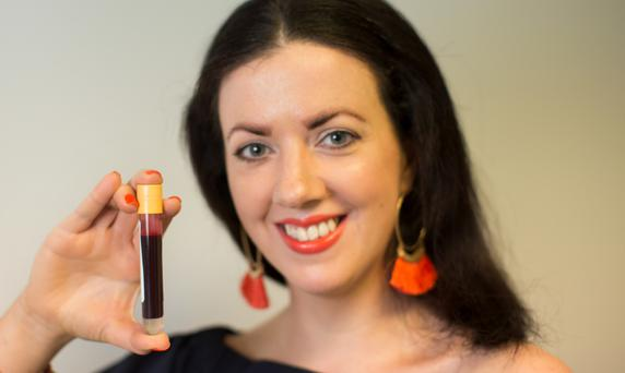 Waiting game: Deirdre Reynolds holds her vial of blood after her fertility test