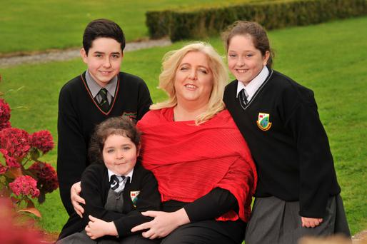 Lucinda McNerney with her three children, Óisin, Dervla and Aoife. Photo: Daragh Mc Sweeny/Provision