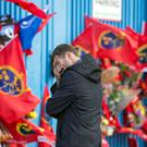 Vulnerable side: A Munster fan grieve's at the gates of Thomond Park, Limerick for Ireland and Munster rugby player Anthony Foley.