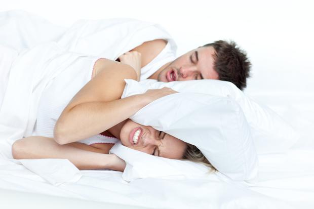 Try elevating your bedhead by a few inches, or else encourage a more comfortable side-sleeping position by using an orthopaedic pillow