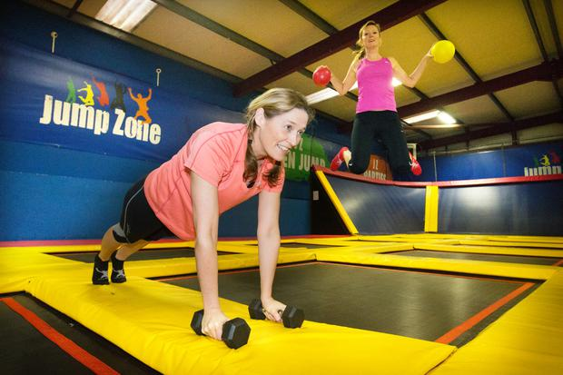 Spring in their step: Roisin Finlay and Helen Vaughan get some trampoline excersise in Jump Zone
