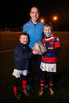 Under 11's Rugby Coach Shane Meehan with his sons Andrew (8) and Matthew (10) at Clontarf Rugby Club.