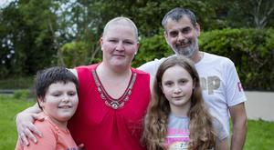 'Getting on with it': Carol with her husband Kevin and her two children Daniel and Niamh. Picture: Arthur Carron