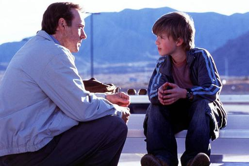 A helping hand: Kevin Spacey and Haley Joel Osment offer strangers random acts of kindness in Pay It Forward
