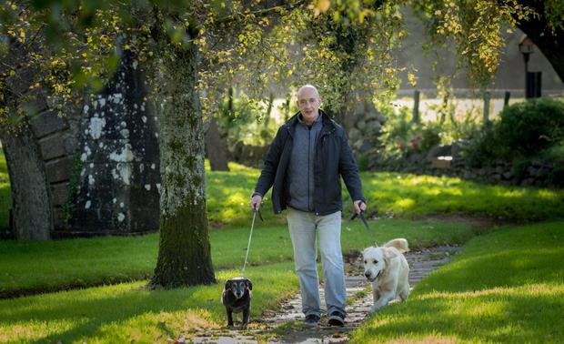 Paul O'Rourke near his home in Inistioge, Co Kilkenny with his dogs, Patsy and Stephen. Photo: Dylan Vaughan