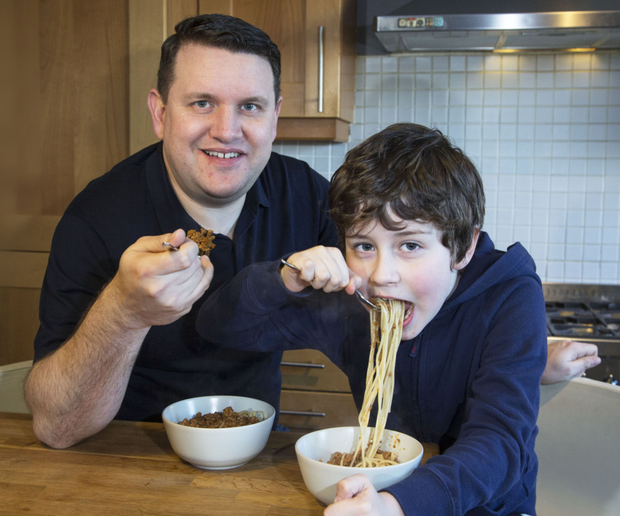 Portion control: Alex Meehan and his son Sam (7) eat spaghetti Bolognese as they test the 400-600-600 diet. Photo: Colin O'Riordan