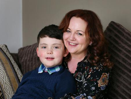 Samantha Judge and her nine-year-old son Evan at their home in Raheny, Dublin. Photo: Frank Mc Grath