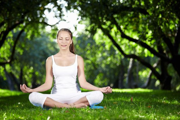 File photo: A woman practicing meditation