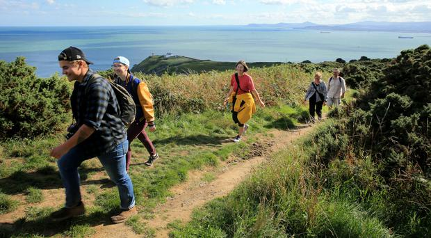 A group of tourists make their way around the trail on Howth Head, Dublin. Photo: Gerry Mooney