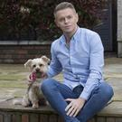 Line of duty: Drag queen Paul Ryder with his dog Millie. Photo: Tony Gavin