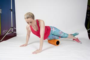 IT BAND 1/ Lie face down on the foam roller, slightly at an angle on the front side of your leg.