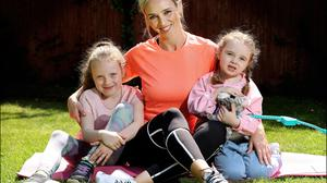 Siobhan Byrne at home in Malahide with her children Regan and Riyanne. Photo: Steve Humphreys.