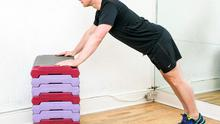 Table press-up: Start with your hands on the table,wider than shoulder width. Keep your bum in the air and back flat