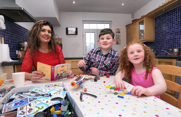Single mum Cliona O'Boyle with son Sean and daughter Holly.