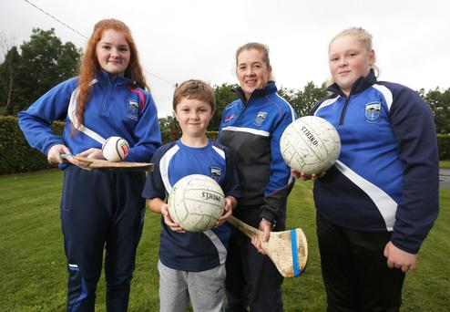 Three-time All-Star Christine with her children (from left) Molly (15), Daniel (8), and 11-year-old Brid at their home in Meath Pic: Damien Eagers