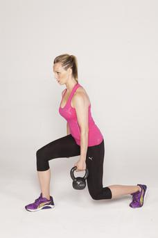 1/ Stand upright holding a kettlebell in one hand by your side, then step forward into a lunge position passing the kettlebell behind your front foot to the other hand.