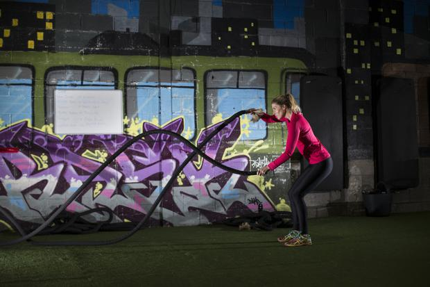 Roped in: Heather uses the battle ropes at FlyeFit gym in Dublin's Macken Street. Photo: Mark Condren