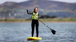 Catherine Etienne of Pure Magic Water Sports paddle boarding at Dollymount. Photo: Steve Humphreys.