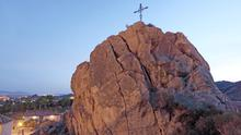 A Christian cross on a rock above the town of Lorca in the province of Murcia, Spain