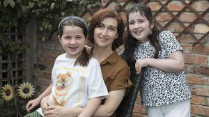 Dr Annie Curtis with daughters Lizzie and Faye who both caught chickenpox recently. Photo: Arthur Carron