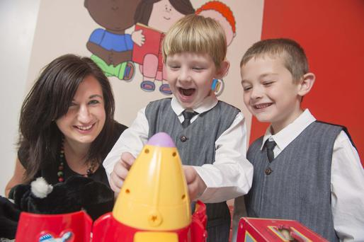 Niamh Sheehan from the Happy Talk programme, with Connor and Cillian Fenton. Photo: Michael MacSweeney