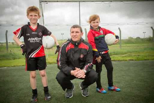 Niall Murray and his two children, Kate and Conor who are attending the GAA Cúl Camp at St. Mary's GAA, Sligo. Photo: James Connolly.