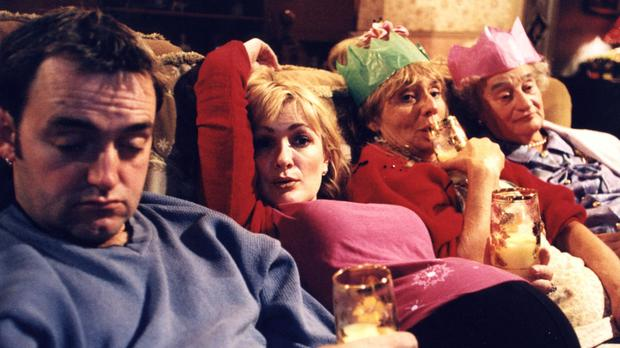 Couch potatoes: Cast members of The Royle Family kicking back after Christmas dinner