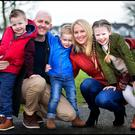 Brian Dillon with his wife Celine and their children, Ryan (5), Josh (3) and Isobel (7). Photo: Colin O'Riordan