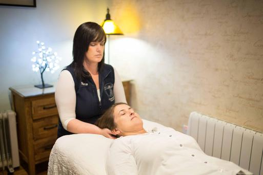 Eyes wide shut: Arlene relaxes under the care of craniosacral therapist Maria Miniter. Photo: Eamon Ward