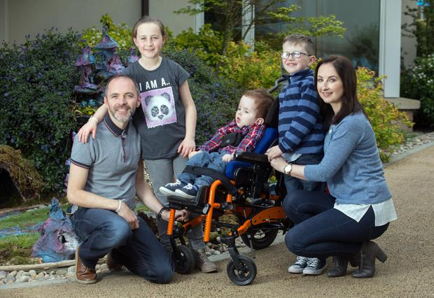 Alice and Kieran Shiels with their children Senan, Conall and Cara at the LauraLynn centre in Leopardstown. Photo: Tony Gavin