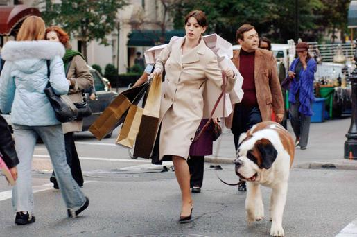 It's in the bag: Anne Hathaway plays Andy Sachs who is forced to juggle many tasks at once in The Devil Wears Prada