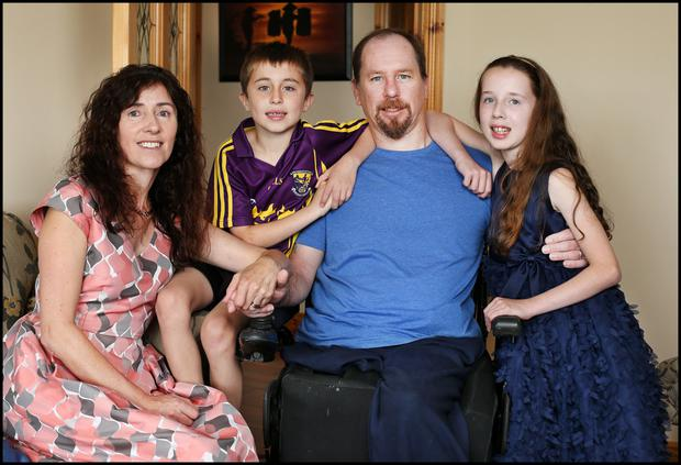 Gerald Shannon and his wife Bridget at home with their two children Josh (8) and Leah (10). Photo: Steve Humphries
