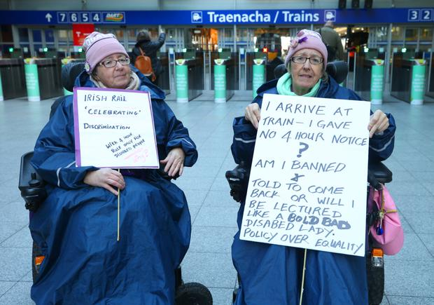 Twins Margaret Kennedy and Ann Kennedy protest before the launch of the Dart Improved Accessibility Pilot at Connolly Station. Photo: INM