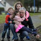 Leo Hynes with his children Lauren (seven), Fiadh (four) and Aibhinn (three). Photo: Ray Ryan
