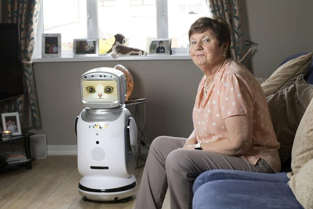 Bridget Byrne with Mylo at home.Bridget is testing the robot which has been designed to help people with challenges. Photo: Tony Gavin