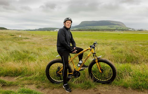 Actor Ciarán McCauley gets pain relief from cycling his bike across the dunes in Strandhill, Co Sligo. Photo: James Connolly