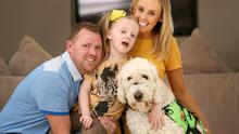 Stephen, Layla and Edel Farrell with Layla's service dog, Google. Photo: Gerry Mooney