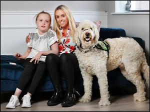 Edel Farrell and daughter Layla (10)  with assistance dog Google. Photo: Steve Humphreys
