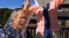 Former US president George W Bush takes the challenge with some help from his wife Laura
