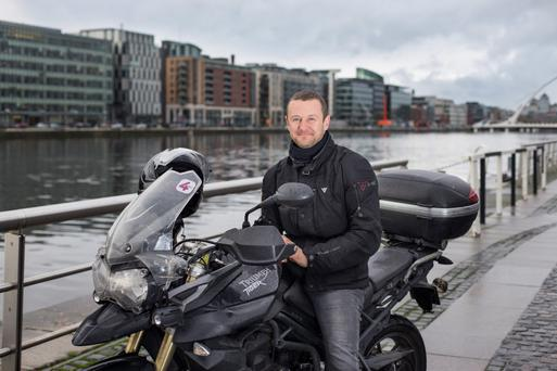 The open road: Comedian PJ Gallagher's happy place is anywhere he can ride his motorbike or cycle his bike. Photo: Mark Condren